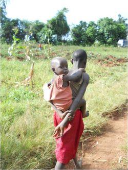 Soteni carrying kid 2