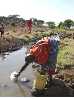 VAC water collecting with man watching 2