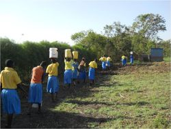 CARE carrying water to school 2
