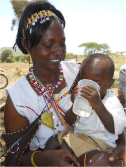 VAC demo 1 mother & child drinking 2